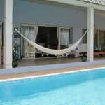 Pool and hammock at the terrace of Ocean Breeze 4